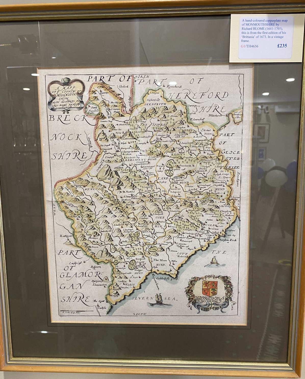 G1 - A hand-coloured copperplate map of MONMOUTHSHIRE by Richard Blome (1641-1705) from his Britannia of 1673. In a vintage frame.  £235