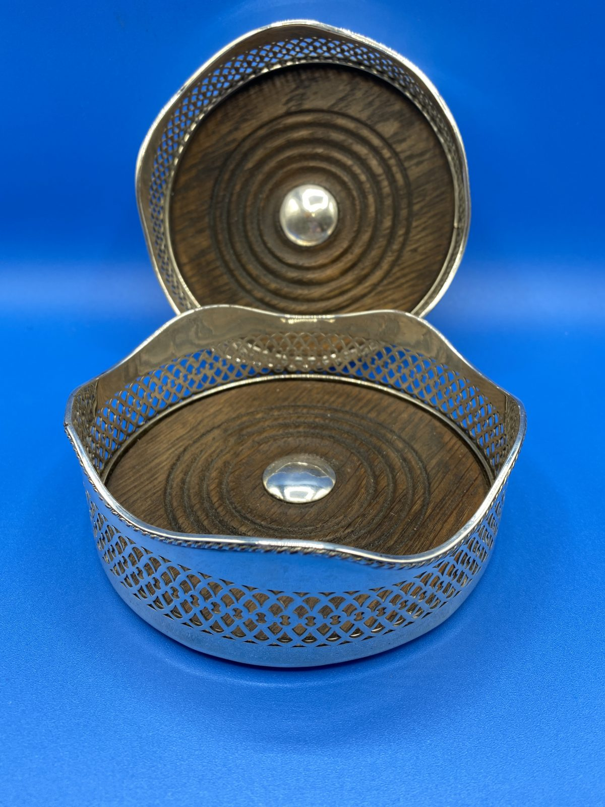 G3 - A Pair of Silver Plated Wine Coasters.  £88