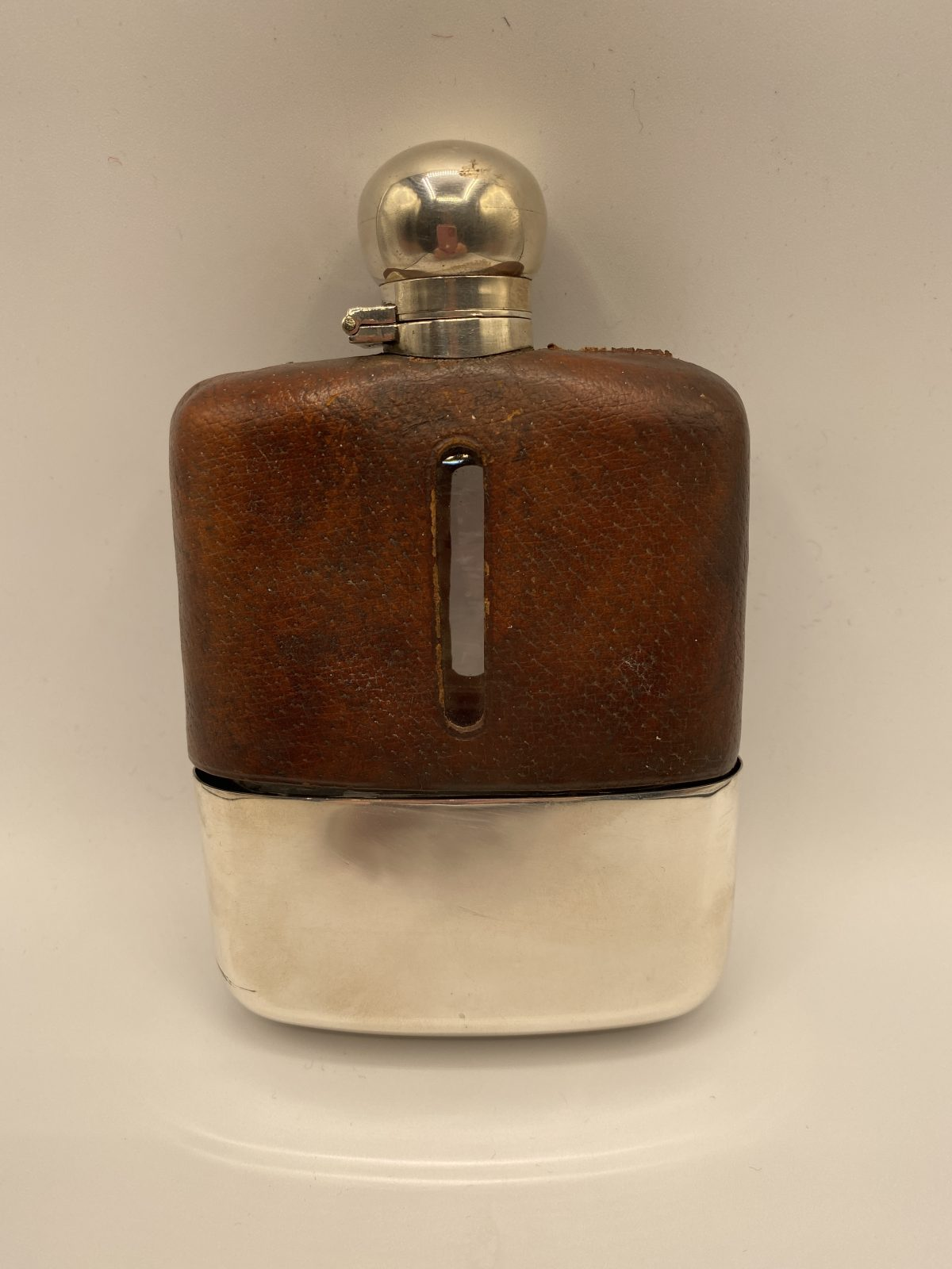 CAB 14 - A Large Hip Flask by James Dixon & Sons, Sheffield 1912.  £369