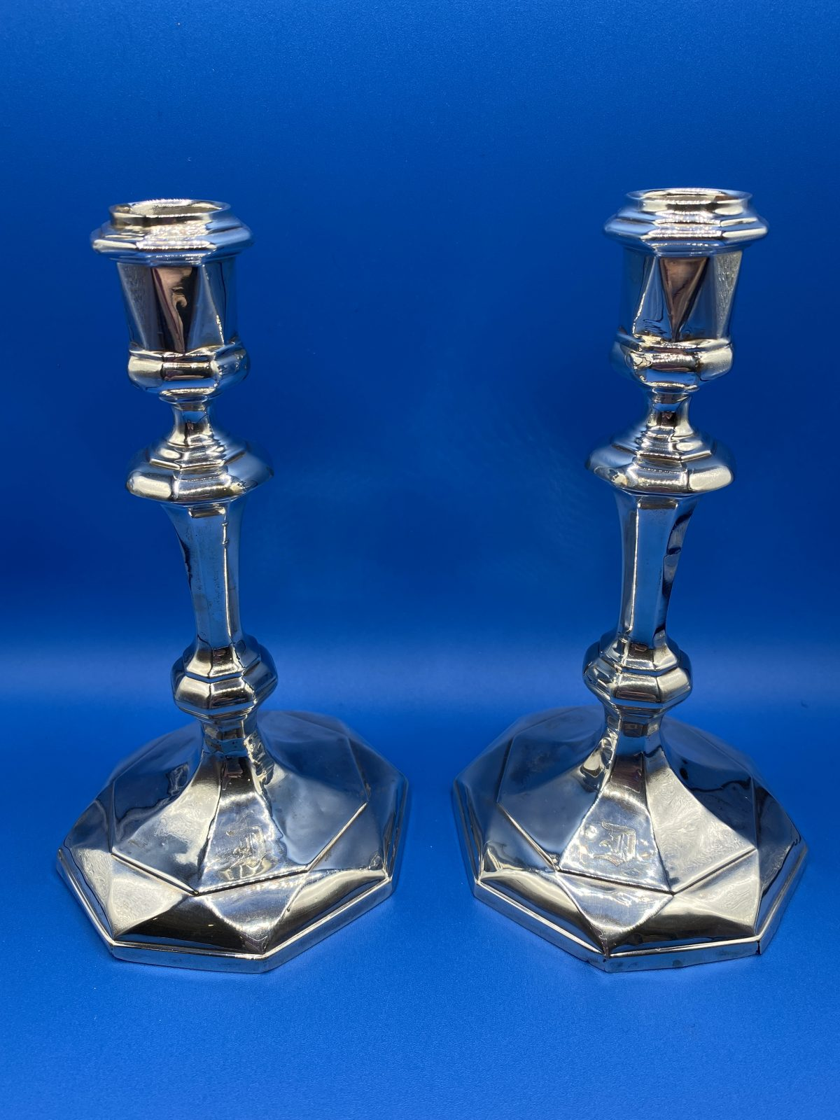 G1 - A Pair of Silver Candlesticks with weighted bases, Sheffield 1920, engraved with the letter E.  £225